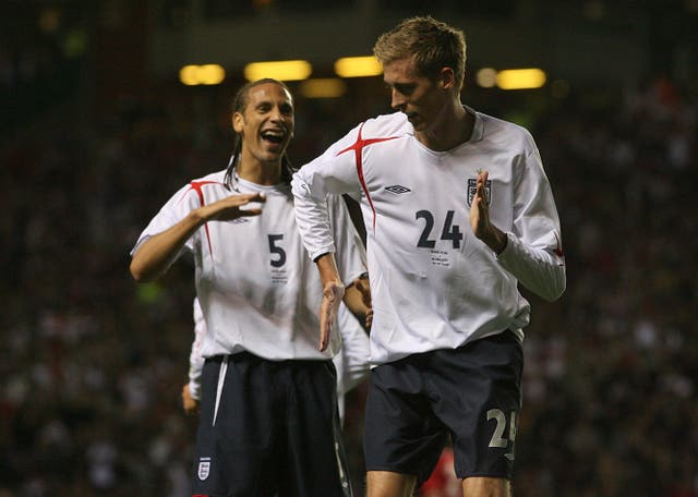 England's Peter Crouch celebrates with the robot dance