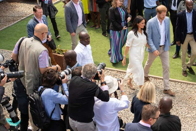 The media watch Harry and Meghan depart after a visit to the Tembisa township in Johannesburg