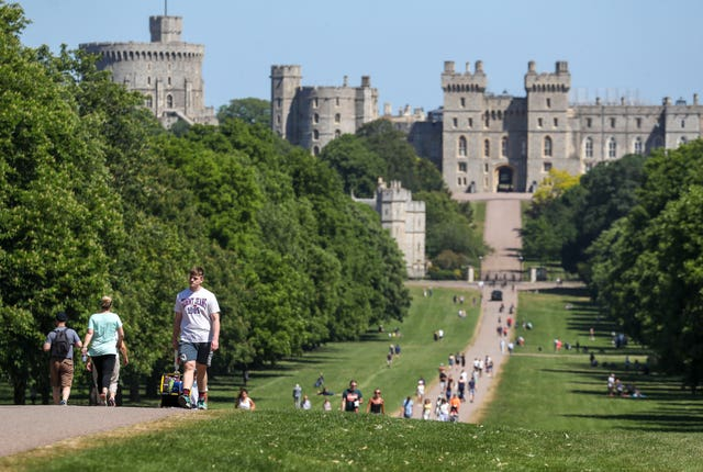 Meanwhile, people enjoyed the hot weather on the Long Walk at Windsor Castle, Berkshire