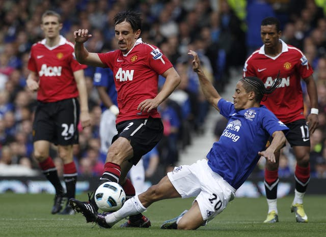 Gary Neville, left, came through the United academy
