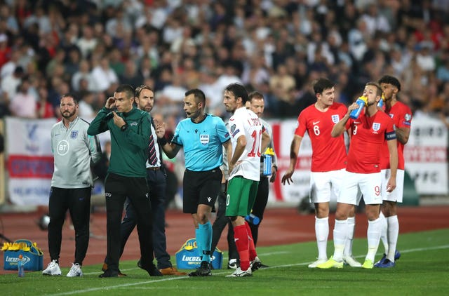 Referee Ivan Bebek (centre) twice stopped England's match in Bulgaria
