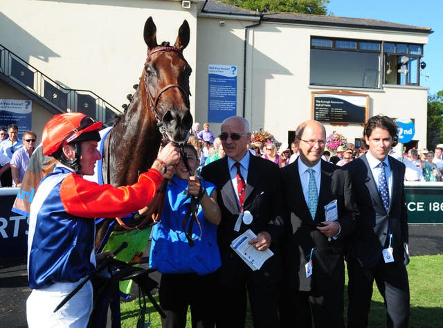 Connections of Chicquita following her victory in the Irish Oaks