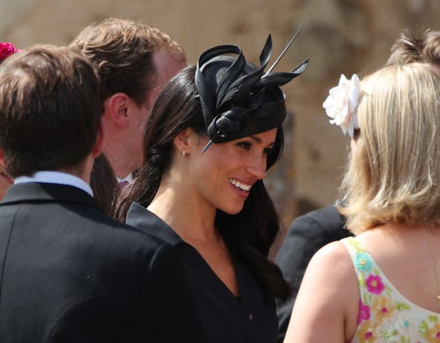 Meghan chatting to guests