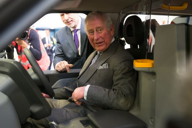 The Prince of Wales is shown a new model taxi at the London EV Company in Coventry