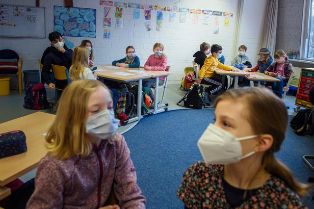 Pupils attend a school in Kiel, northern Germany