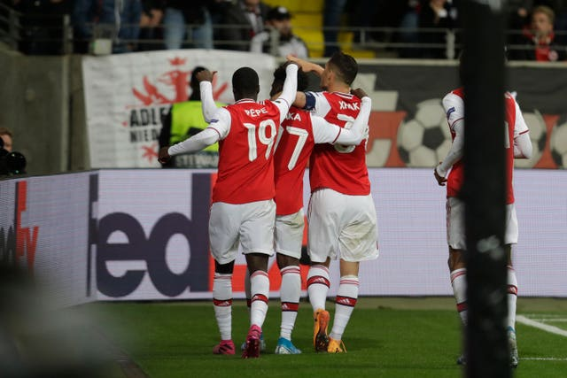 Arsenal's players celebrate with Saka