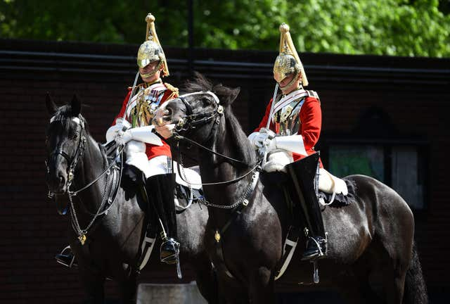 Members of the Household Cavalry ready for inspection in the Regimental Square at Hyde Park Barracks (Kirsty O'Connor/PA)