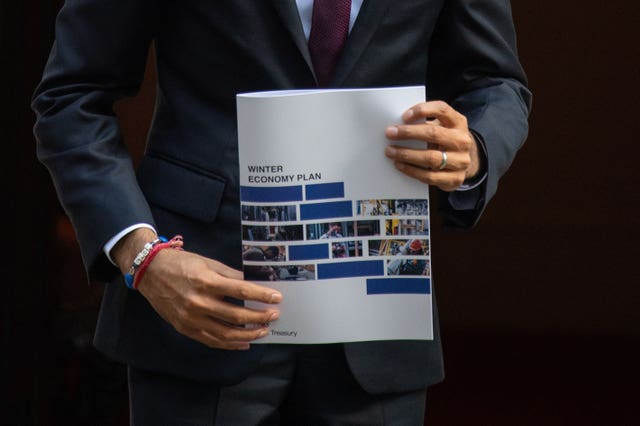 Chancellor Rishi Sunak holds a copy of his Winter Economy Plan