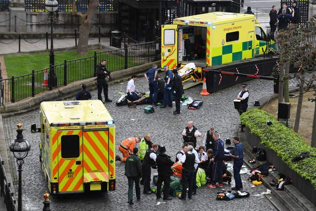 Emergency services attending Khalid Masood, top, and police officer Keith Palmer, bottom, outside the Palace of Westminster after Masood ploughed into pedestrians on Westminster Bridge