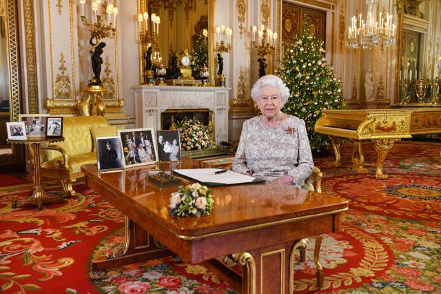 The Queen after she recorded her Christmas Day message, in the White Drawing Room of Buckingham Palace (John Stillwell/PA Wire)