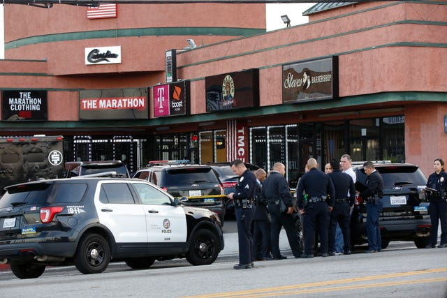 Police investigators gather around the Marathon Clothing store of rapper Nipsey Hussle in Los Angeles