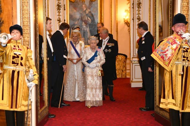 The Queen, the Prince of Wales and the Duchess of Cornwall and the Duke and Duchess of Cambridge attend an evening reception for members of the Diplomatic Corps at Buckingham Palace