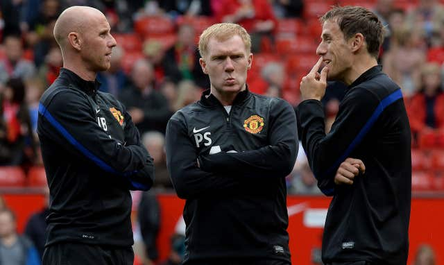 Scholes, centre, pictured during his stint as a United coach in 2014