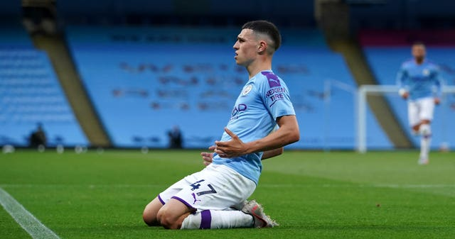 Manchester City's Phil Foden celebrates after scoring his side's third goal against Liverpool
