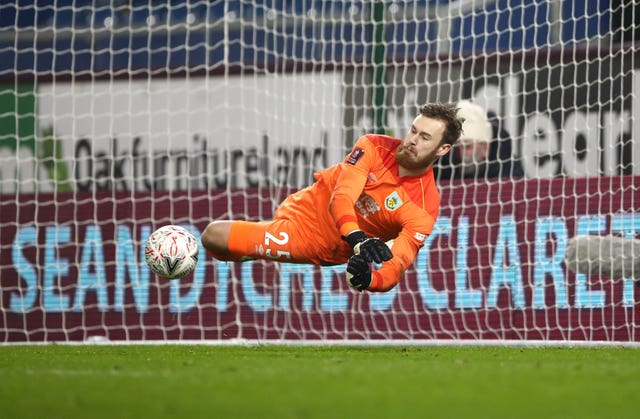 Will Norris saves from Lasse Sorensen in the penalty shoot-out