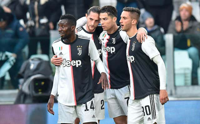 Cristiano Ronaldo, second from right, celebrates with team-mates after scoring Juventus' second goal
