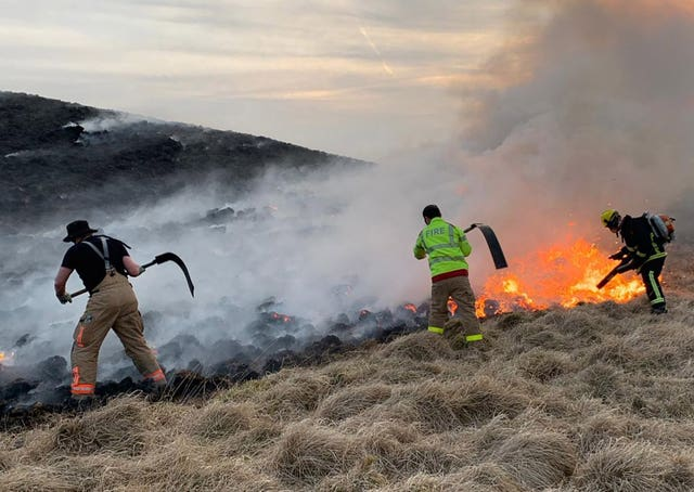 Firefighters at work in Lyme Park