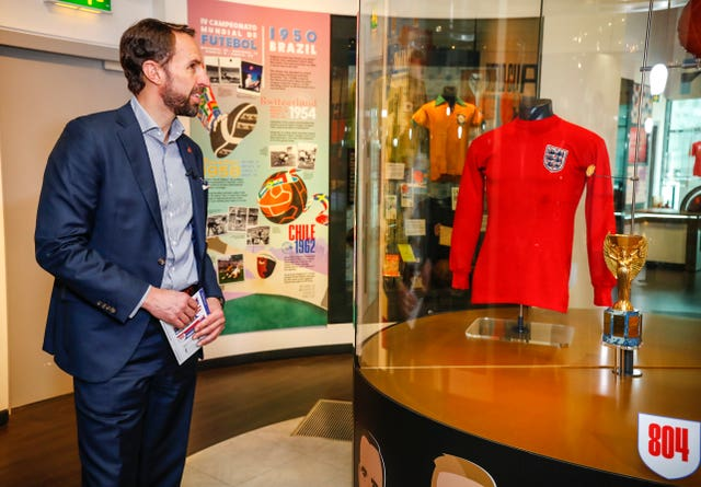 Gareth Southgate looking at an England shirt from the 1966 World Cup final
