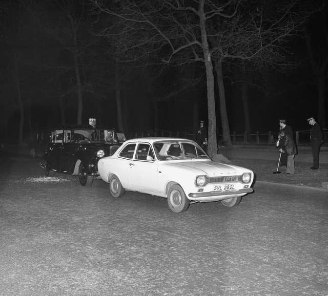 Ian Ball's Ford Escort, and the royal car close behind