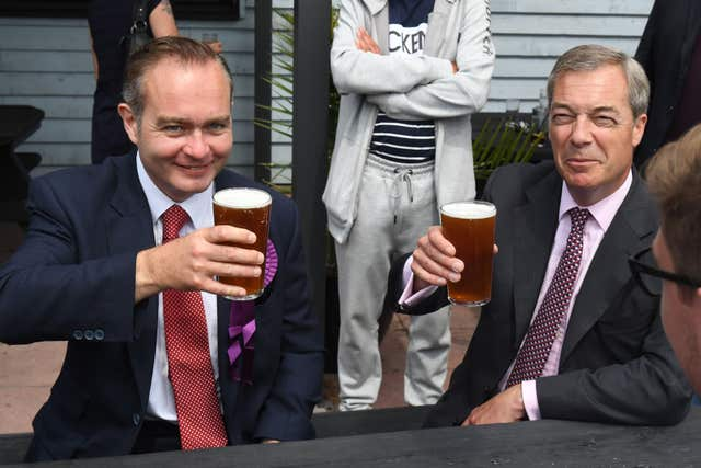 Paul Oakley, pictured with Nigel Farage, hit out at Henry Bolton's leadership (Victoria Jones/PA)