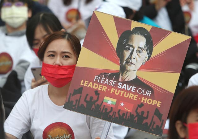 Myanmar nationals living in Taiwan hold placards to express their opinion against the military regime