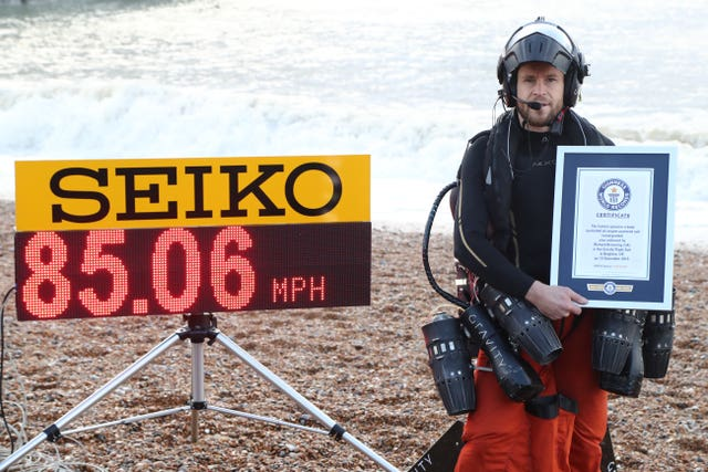 Richard Browning with the Guinness World Record for the fastest speed in a body-controlled, jet engine-powered suit