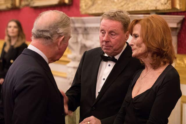 Charles speaks to Harry Redknapp and his wife Sandra (John Phillips/PA)