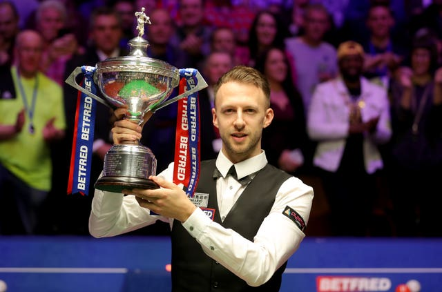Judd Trump, the reigning world champion, trails Kyren Wilson