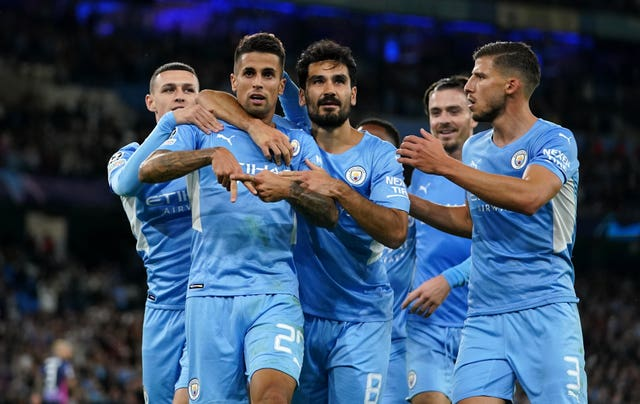 Joao Cancelo (second left) celebrates with his Manchester City team-mates after scoring the fifth goal