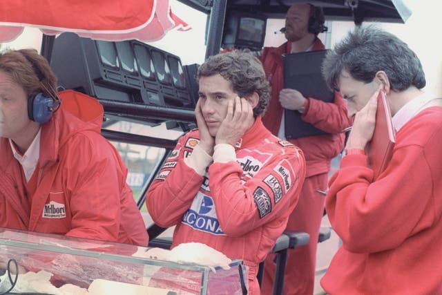 Ayrton Senna, centre, shields his ears from the engine noise during the testing session at Silverstone