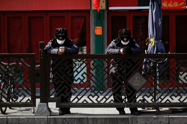 Security guards wearing protective face masks in Beijing
