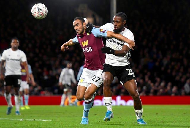Aston Villa's Ahmed Elmohamady, left, and Fulham's Josh Onomah battle for the ball
