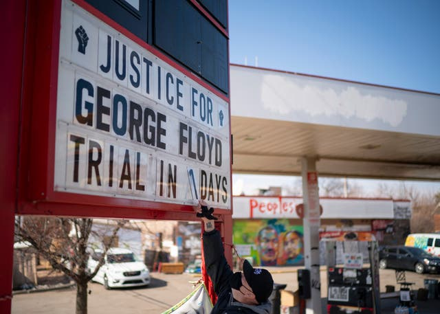 Billy Briggs, who lives just 170 steps from where George Floyd was killed, created and maintains the countdown sign at the petrol station on the corner of George Floyd Square in Minneapolis, Minnesota
