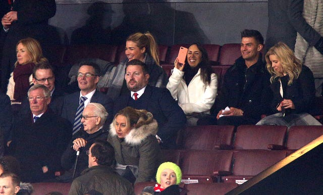 The group in the stands with Sir Alex Ferguson (left) and Manchester United group managing director Richard Arnold (centre)