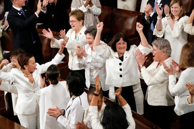 Female members of Congress cheer after Mr Trump acknowledges more women in Congress