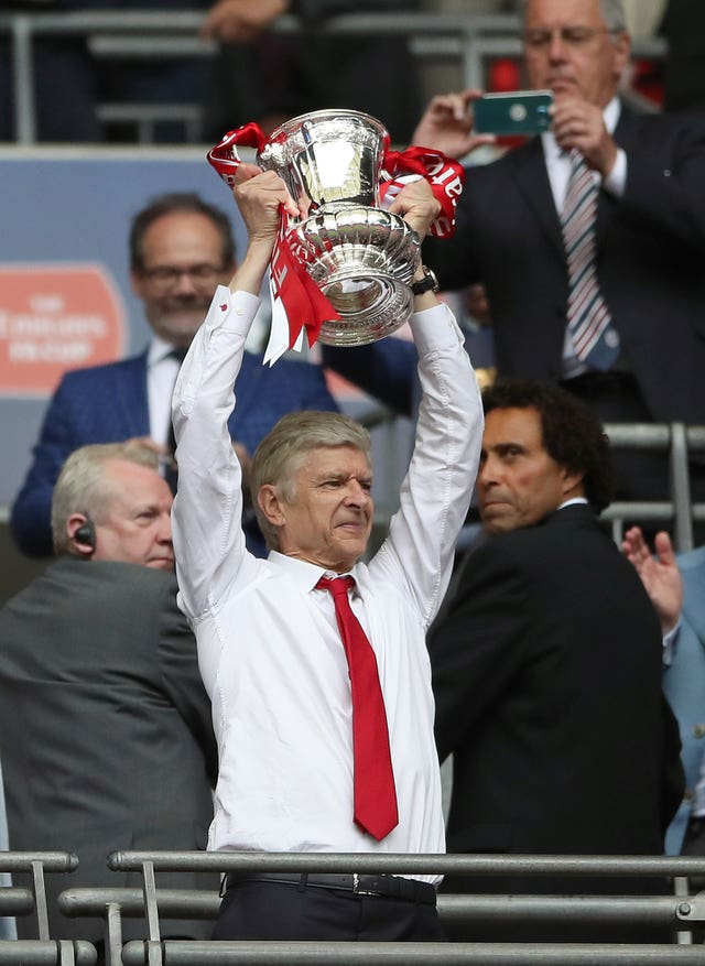 Arsene Wenger has lifted the trophy three times under the arch
