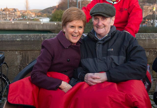 SNP leader Nicola Sturgeon joined Cycling Without Age user Cyril Corcoran, aged 78, in an electric tricycle during a visit to Hawick in the Scottish Borders