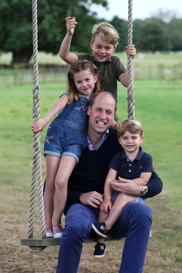 The Cambridges on a swing