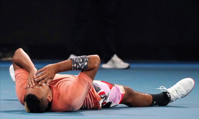 Nick Kyrgios lies on the court after his dramatic victory