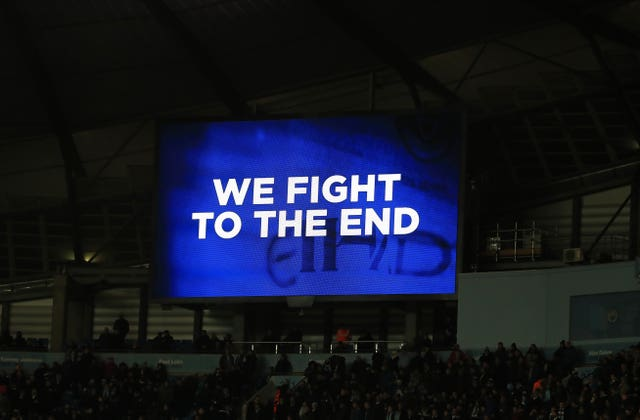 City show their defiance on the big screen during their derby defeat at the Etihad Stadium
