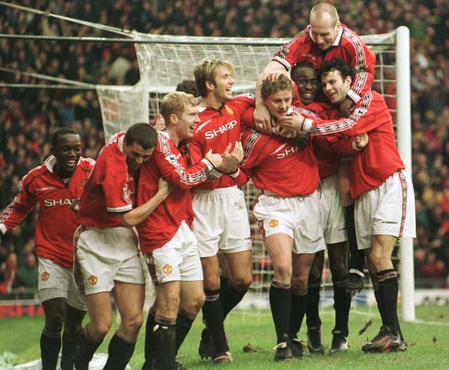 Ole Gunnar Solskjaer is mobbed by his team-mates after his goal on January 24, 1999