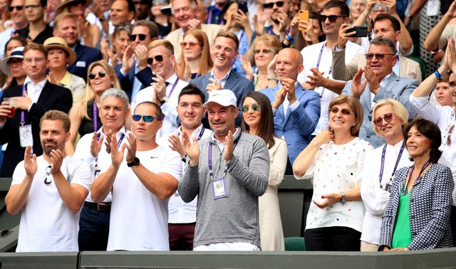 Simona Halep's family and coaching team celebrate her victory