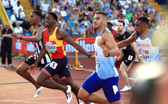 Ojie Edoburun, second left, wins the 100m at the British Championships