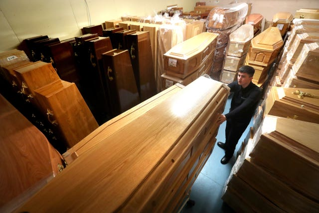 Empty coffins in a storage room in Glasgow (Andrew Milligan/PA)