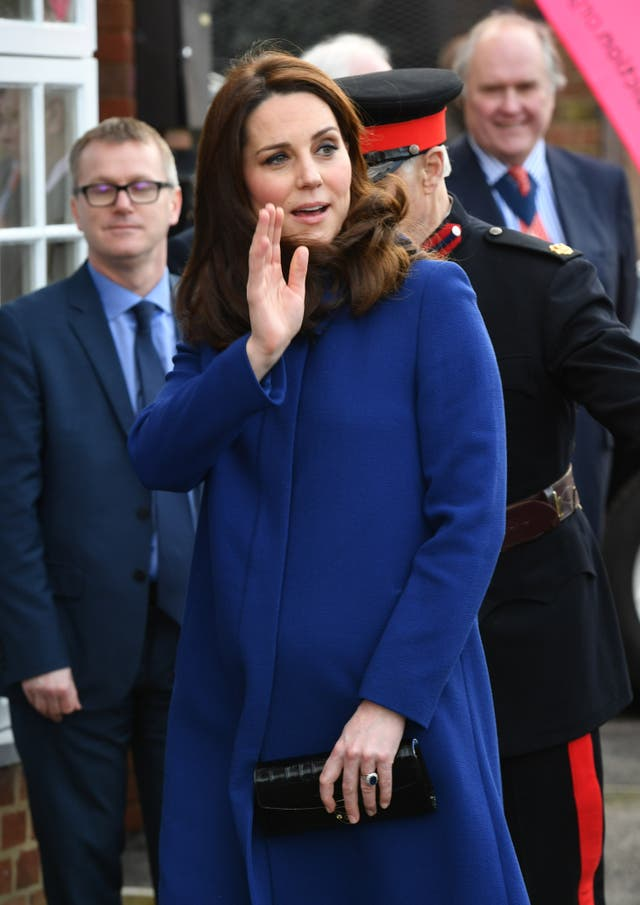 The Duchess of Cambridge waves at the crowd as she arrives to open the Action on Addiction treatment centre (John Stillwell/PA)