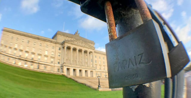 A padlock on a railing outside Stormont