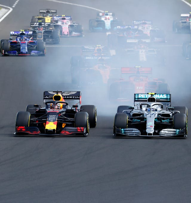 Verstappen, left, and Bottas challenge for the lead at the start of the Hungarian Grand Prix