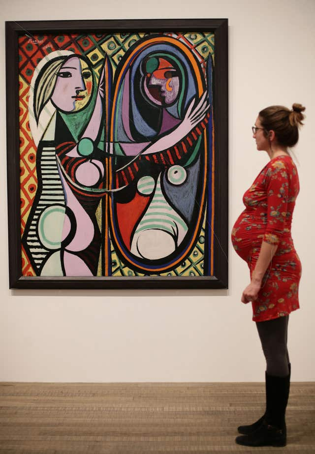 A woman looking at Pablo Picasso's Girl before a Mirror, 1932 (Yui Mok/PA)
