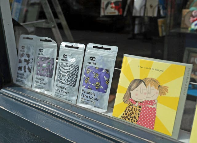 A greeting card shop displaying reusable face covers in the window, on Upper Street in Islington, north London, some six months on from the evening of March 23 when Prime Minister Boris Johnson announced nationwide restrictions