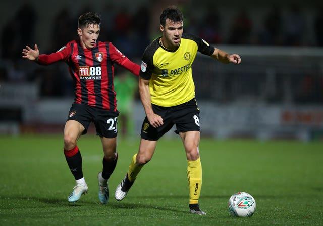 Bournemouth's Harry Wilson and Burton's Scott Fraser battle for the ball